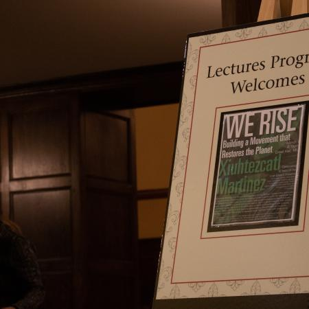 """Martinez sold his book """"We Rise"""" at the event."""
