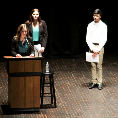 Three students had the privilege of introducing the guest speaker at the Symposium on Sustainability.