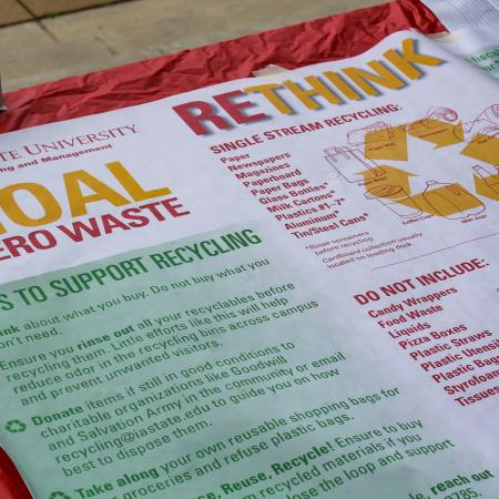 Iowa State Recycling Coordinator Ayodeji Olwalana host a table about recycling at the Celebration Event.