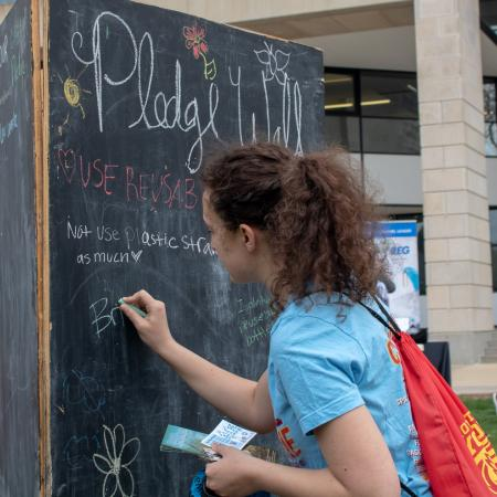 Students wrote down their commitment to sustainability on a chalk board.